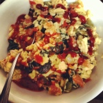 Scrambled eggs with veggies (tomatoes, onions, peppers), pepperoni, and of course ketchup :)