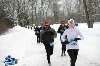 I finally found a picture of myself during the Lake Effect Half Marathon, checkin' out my Garmin, cringing at my pace.